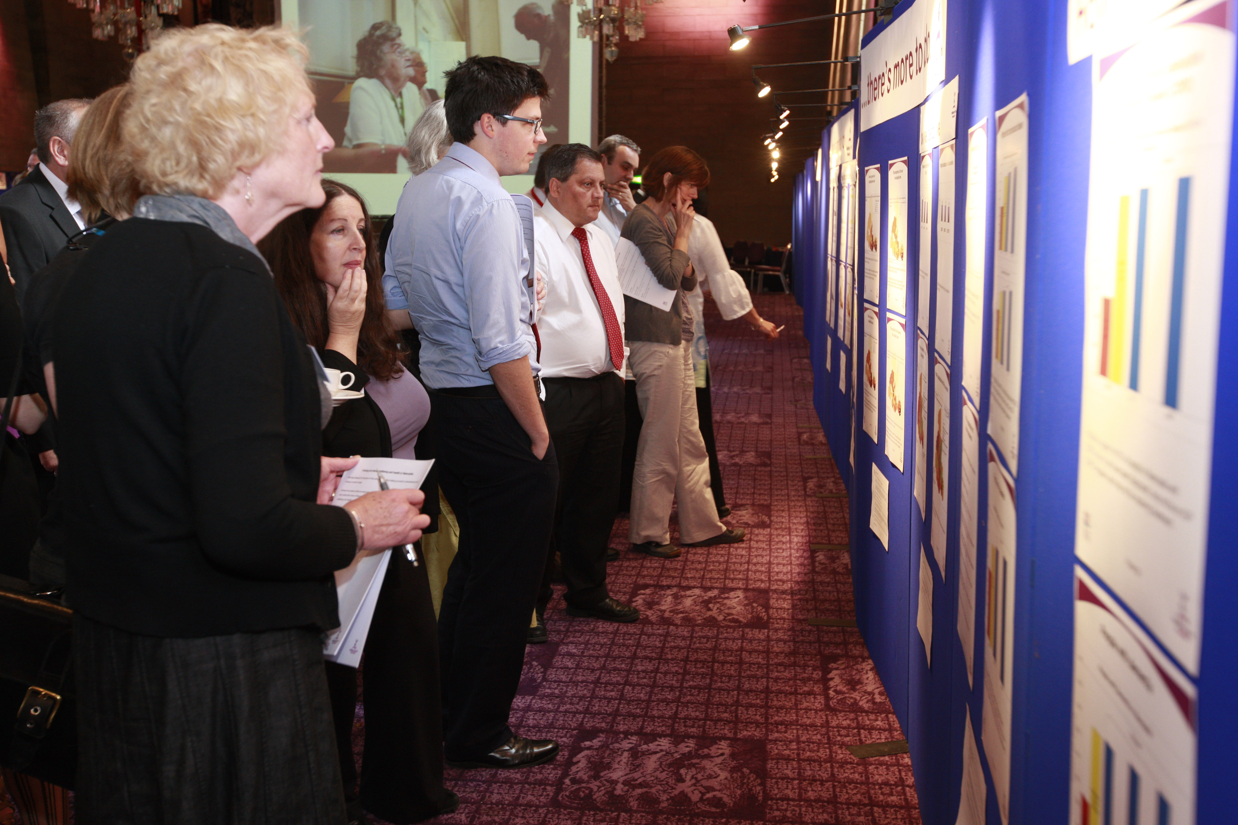 Participants browsing the posters
